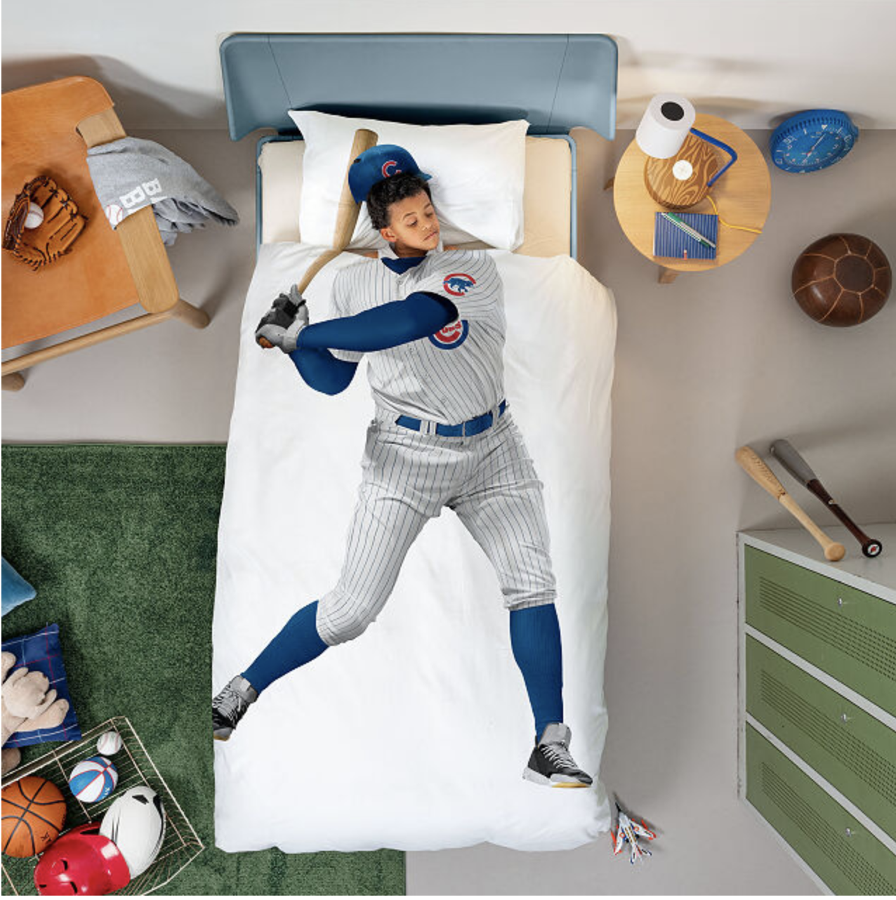 A bedspread with the body of a baseball player on it