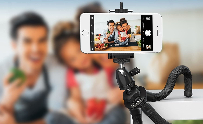 A family takes a photo using the tripod
