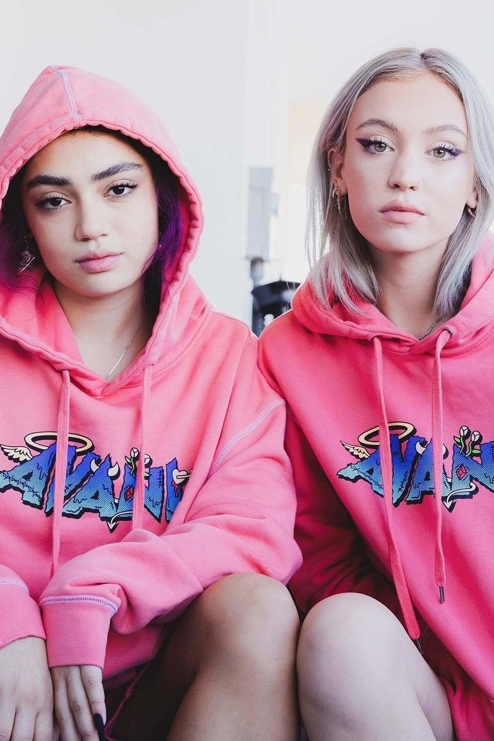 Avani and her friend wear pink hoodies that say her name on them