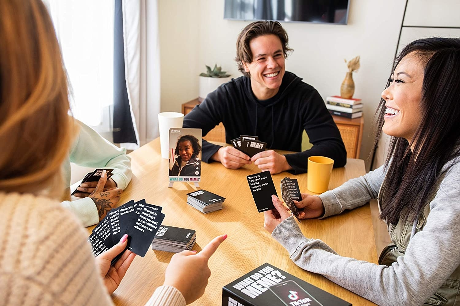 A group of friends play the card game