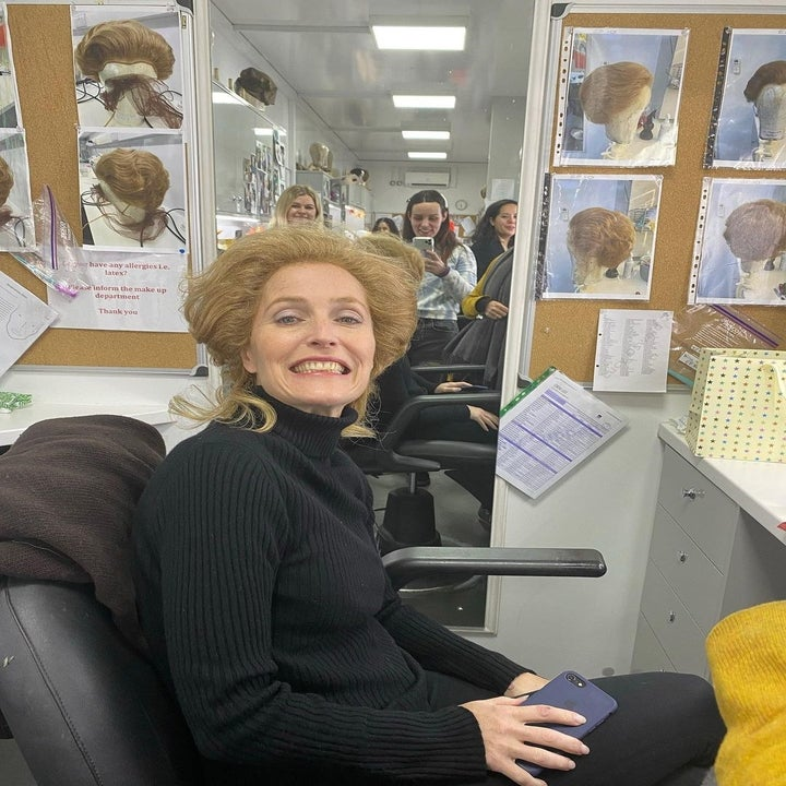 Gillian Anderson wearing a Margaret Thatcher-esque wig in her dressing room trailer