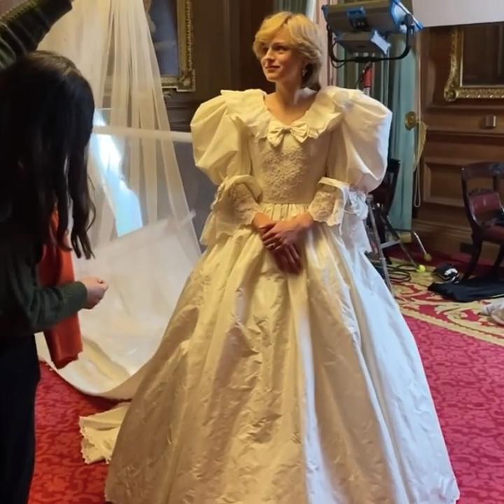 Emma Corrin wearing a recreation of Princess Diana's wedding dress