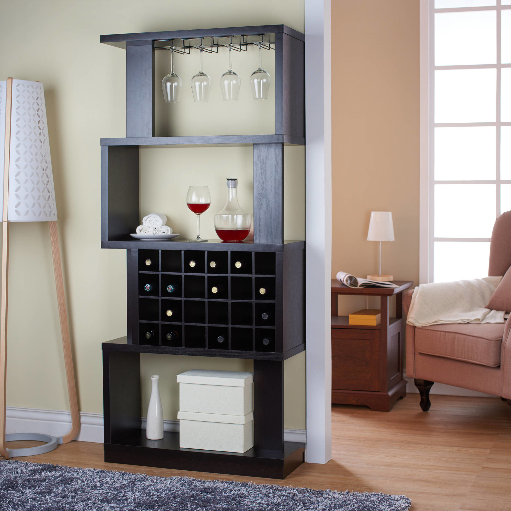 the wine stand in the living room with glasses and wine bottles inside of it