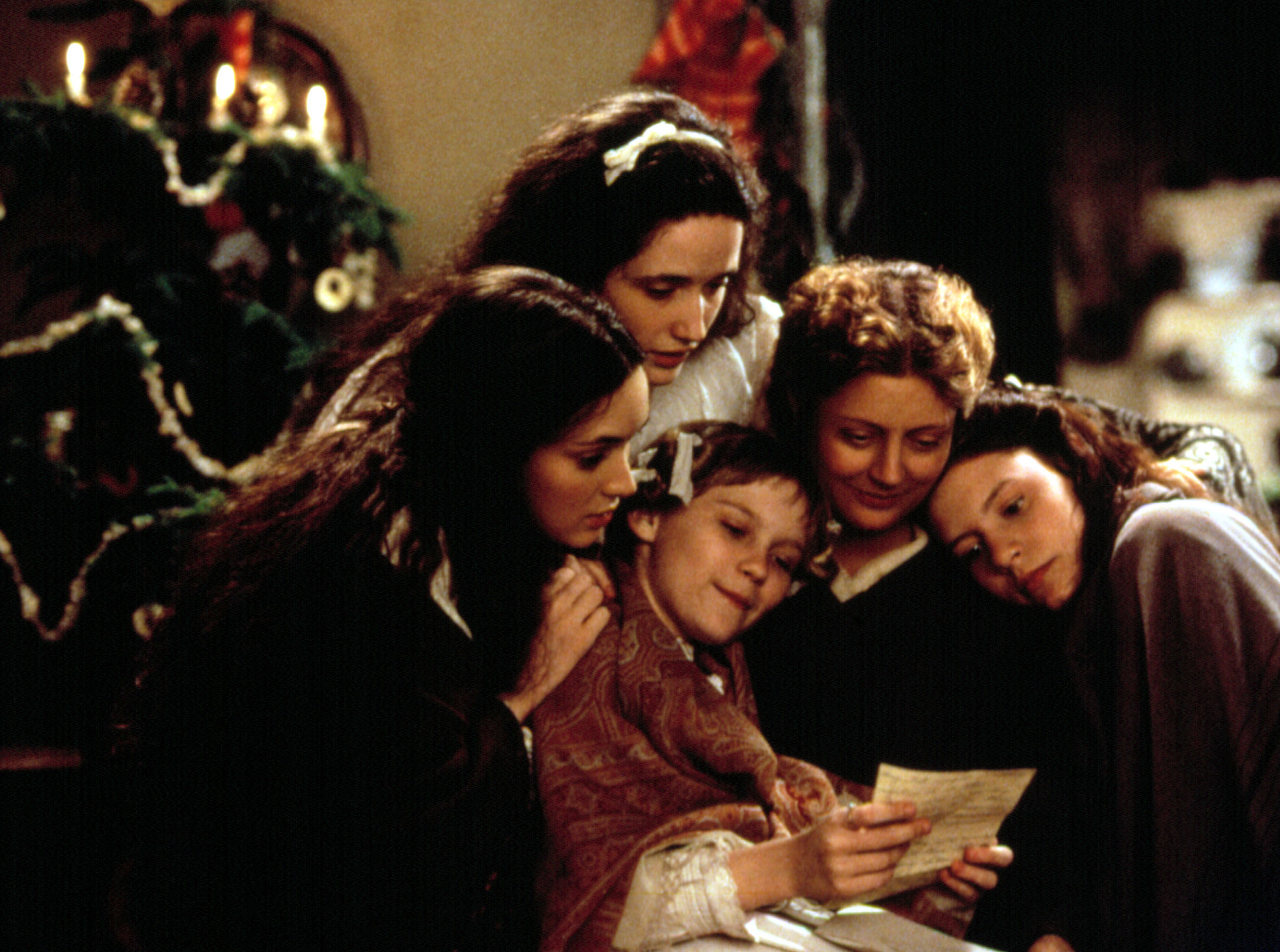 Still from Little Women of Marmie and the four girls gathered around to read their father's letter