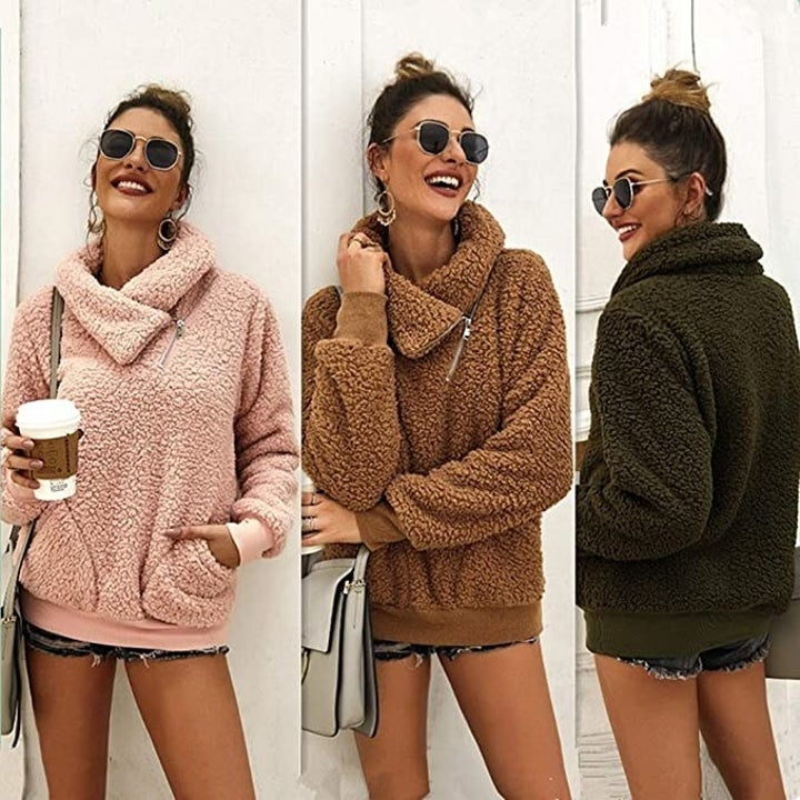 model showing off the sweater in pink, brown, and olive green