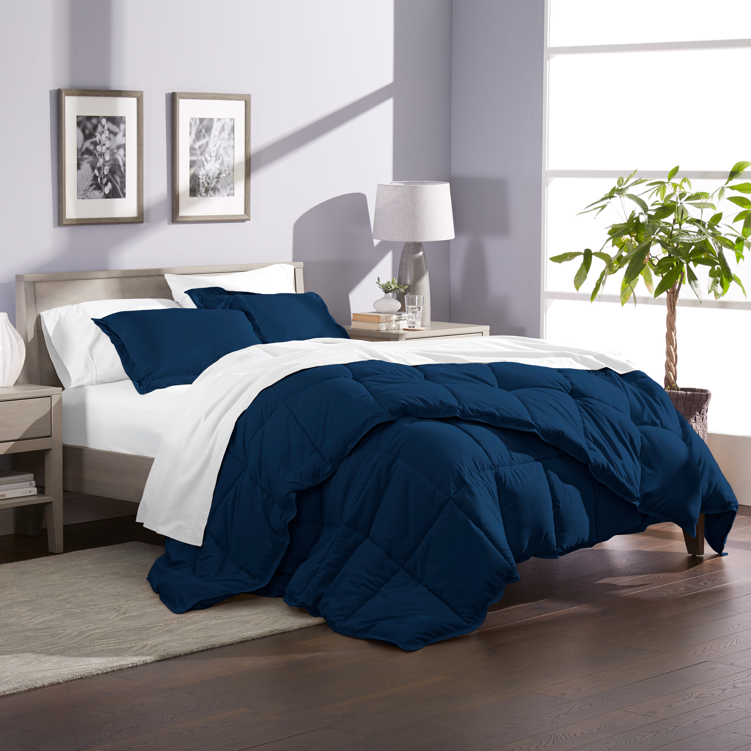 the comforter in navy on a bed