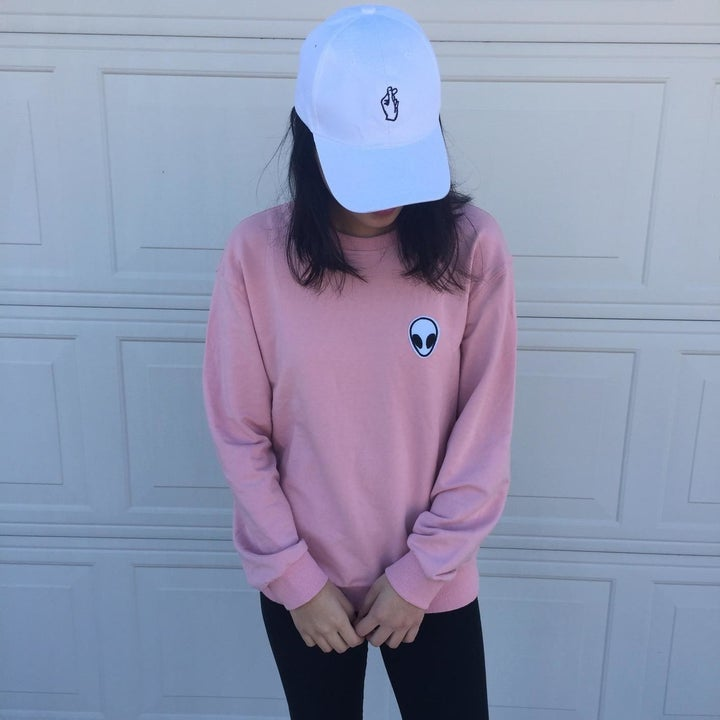 reviewer wearing the pink one with an alien patch in corner