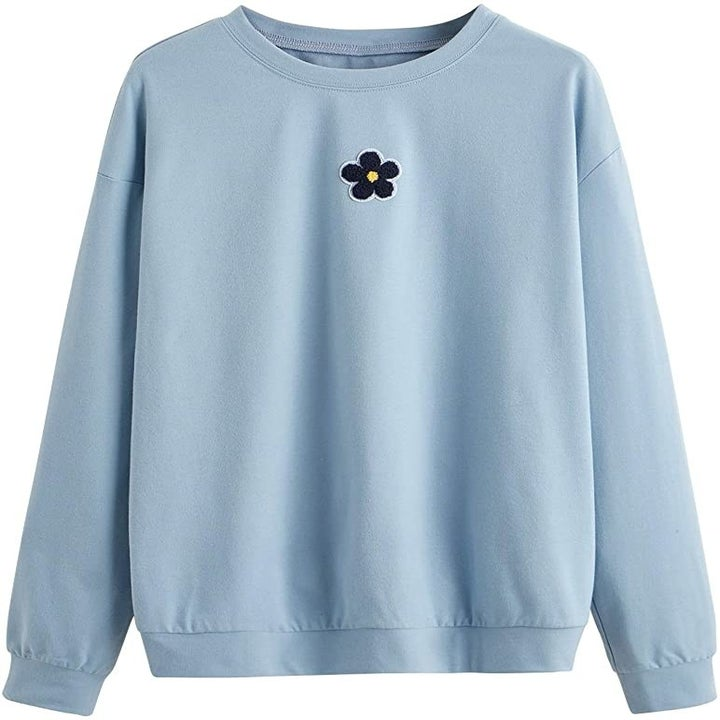 the blue sweater with flower patch in top center