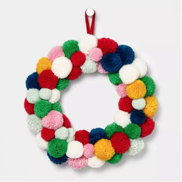 Green, pink, blue, white and yellow pompom wreath