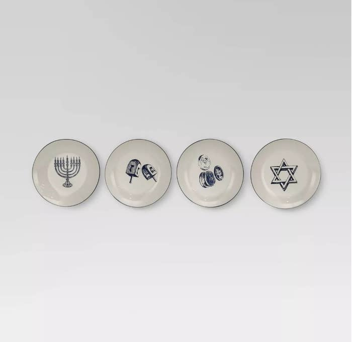 Four ceramic plates with menorah, dreidels, gelt and star of Davi