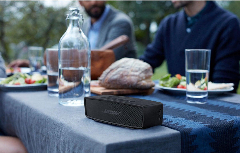 The black mini speaker on a table