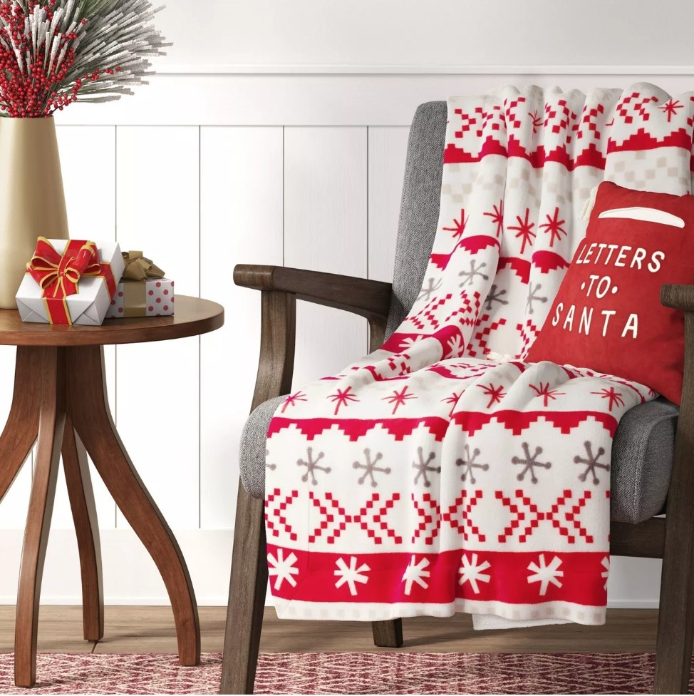 Red and white patterned holiday throw blanket on chair