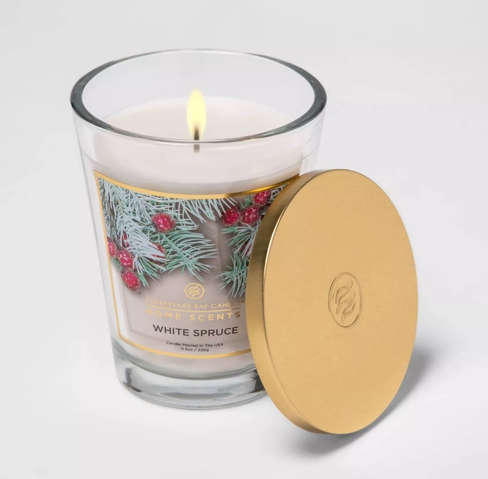 White candle with gold lid