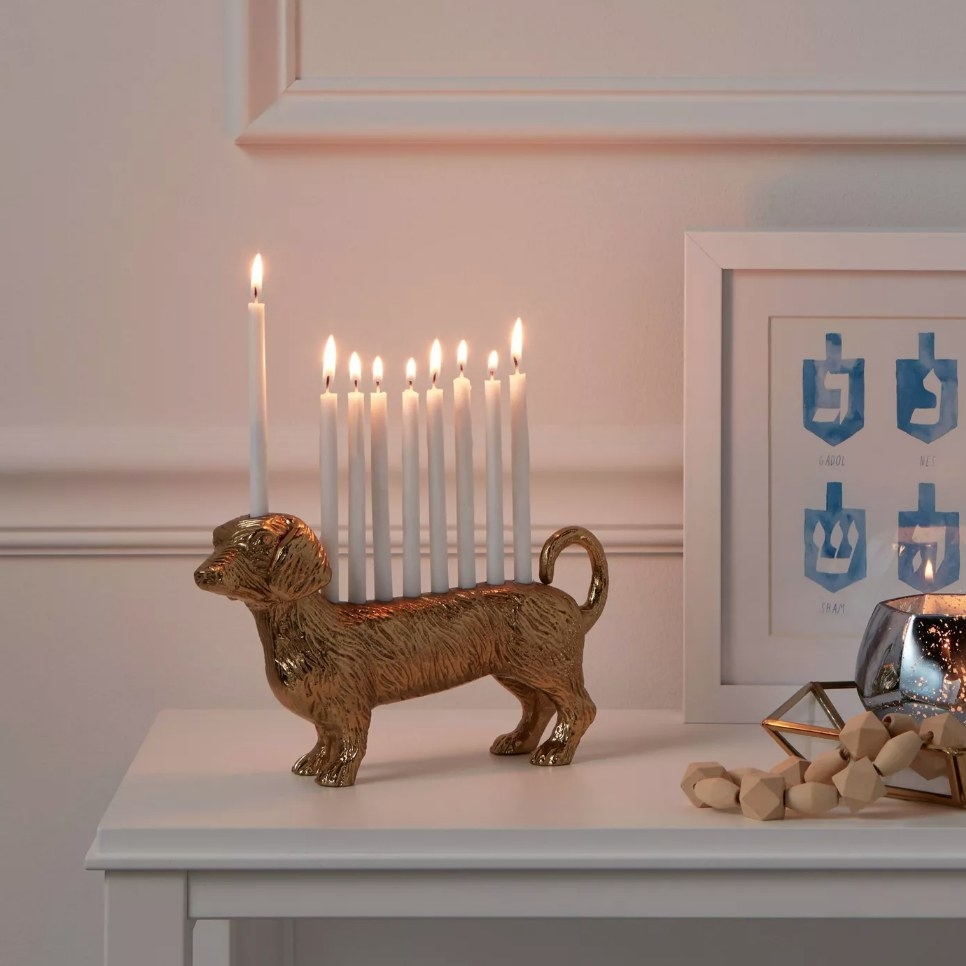Gold dog shaped menorah with lit candles
