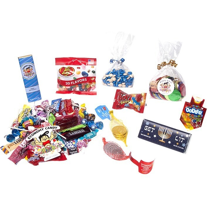 A large pile of small candy, gelt, a Hanukkah-themed chocolate bar, jelly beans, and more