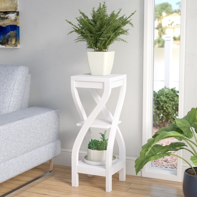 The plant stand in white