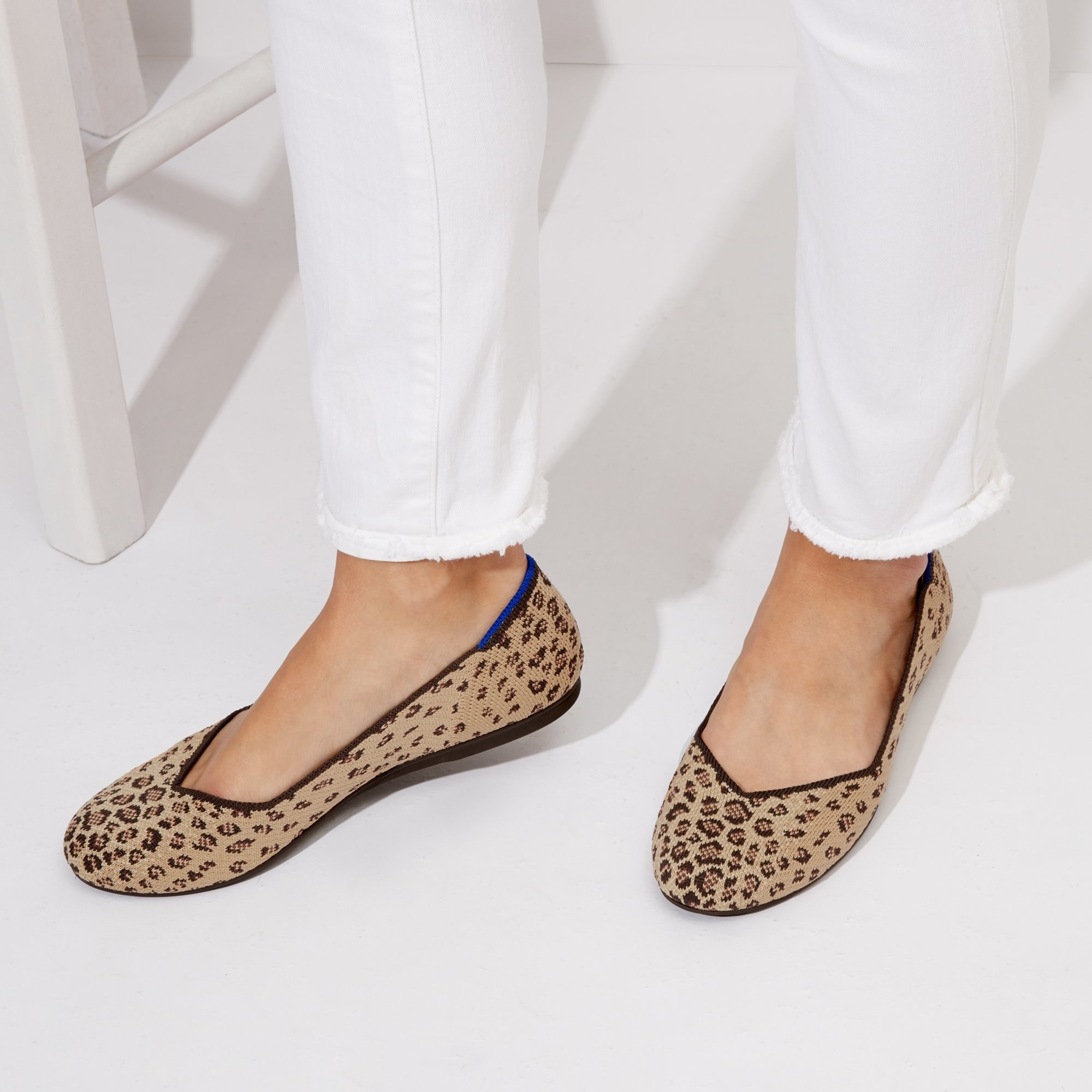 a pair of flats with leopard print