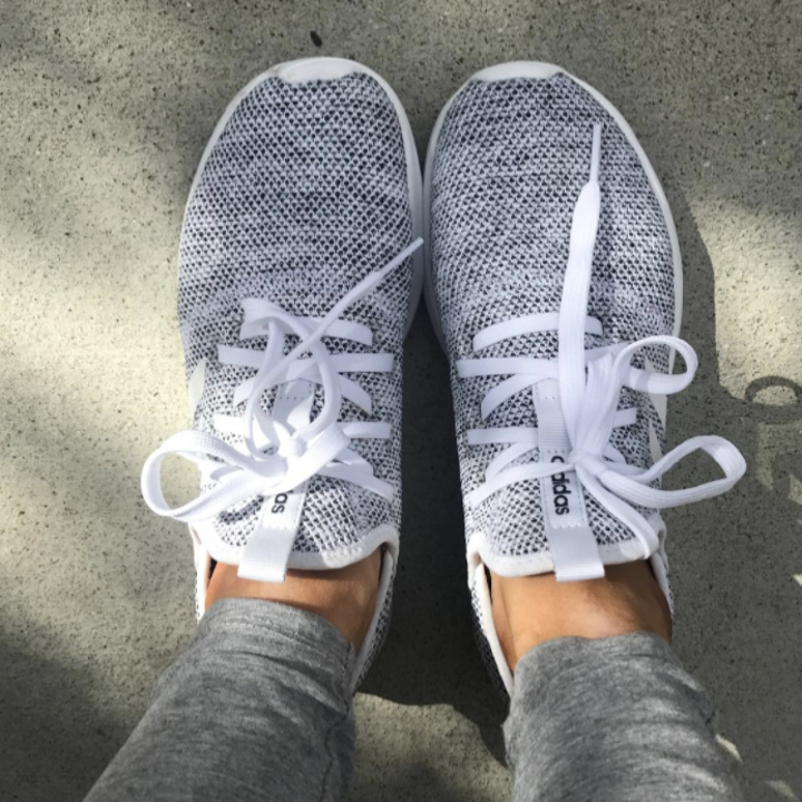 Reviewer wearing gray sneakers
