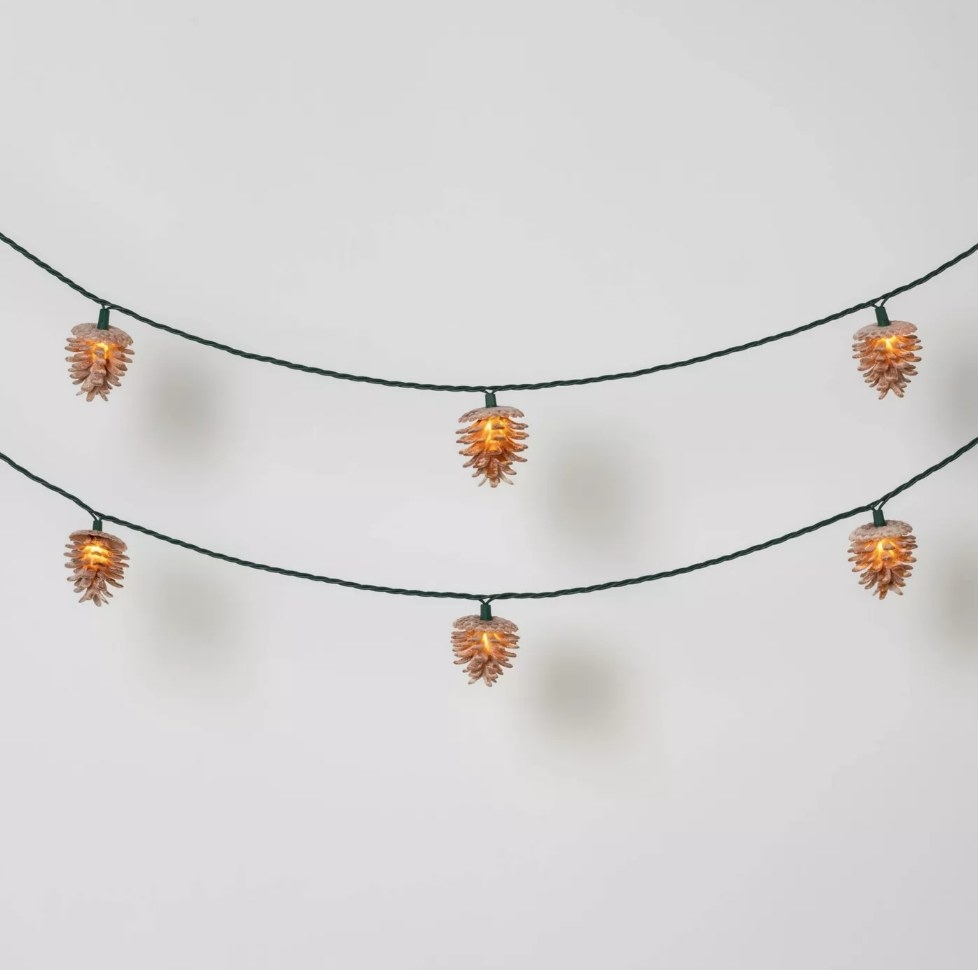 Green wired string lights with frosted brown pine cone shape