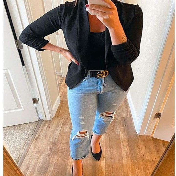 Reviewer wearing black blazer