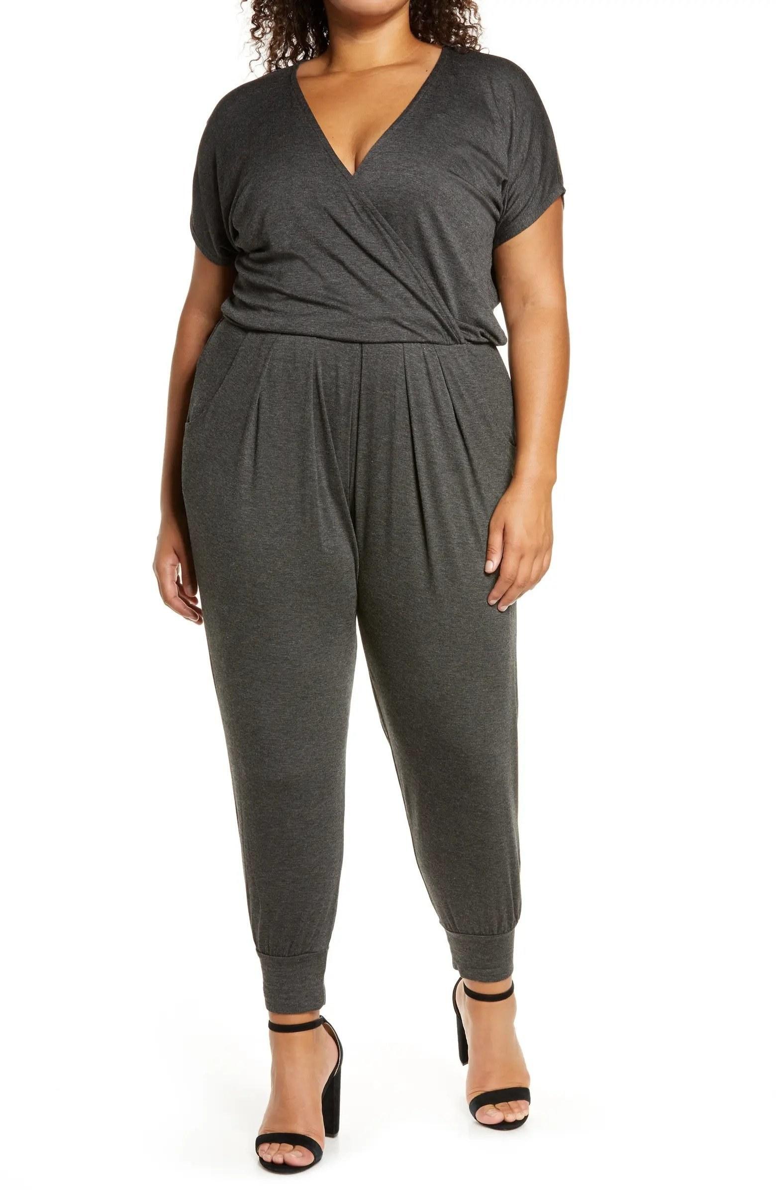 Model wearing gray jumpsuit