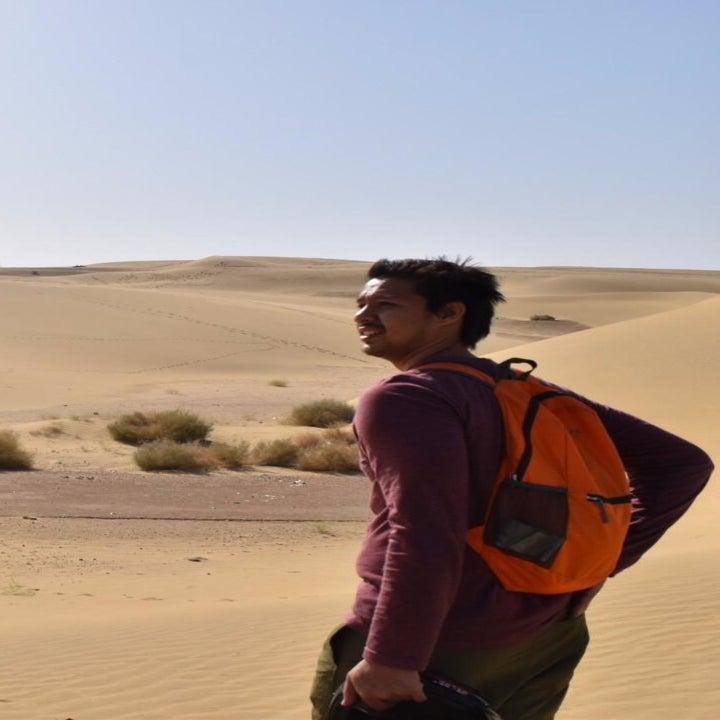 Reviewer wearing orange version in the desert