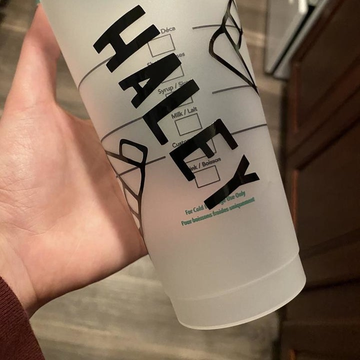 "the cup with the name ""Haley"" printed on it"