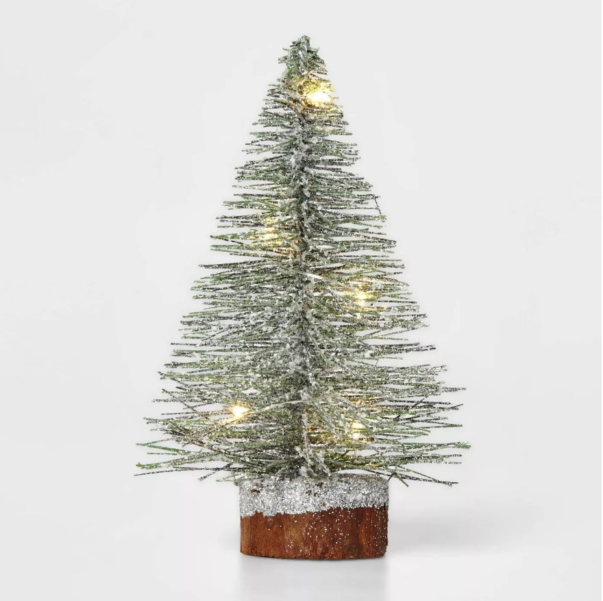 Mini christmas tree with LED lights and silver glitter wooden base