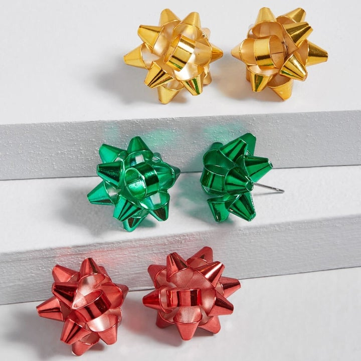 the gift ribbon earrings in red, green, and gold