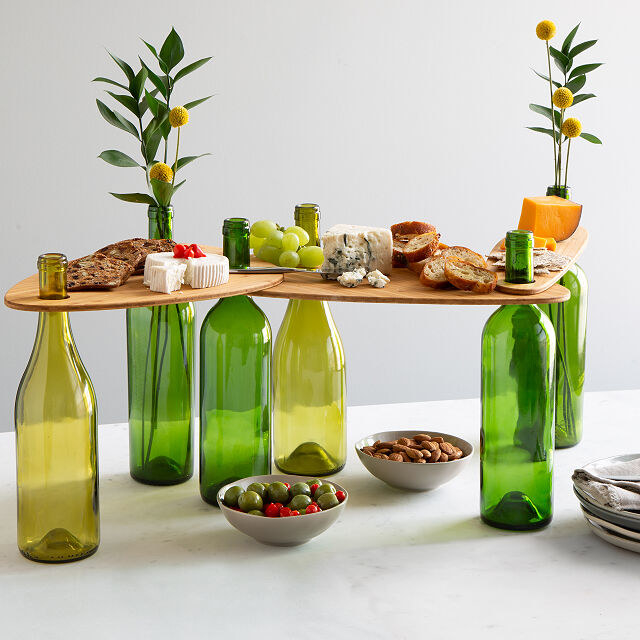 The three wine topper boards being held up by six bottles