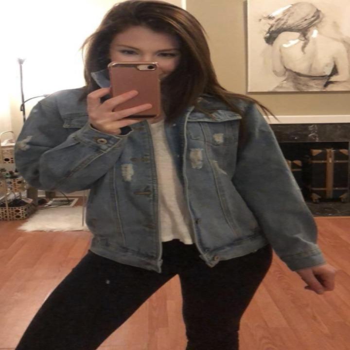 Reviewer wearing denim jacket
