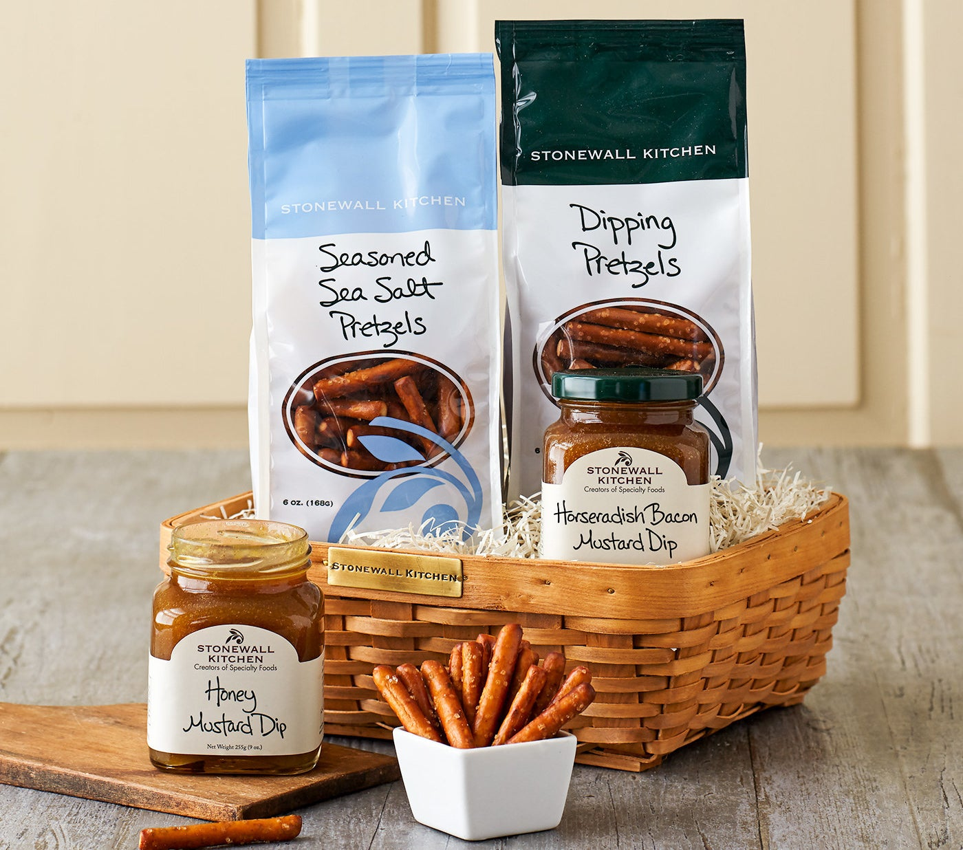 basket with two bags of pretzels and two mustard dips