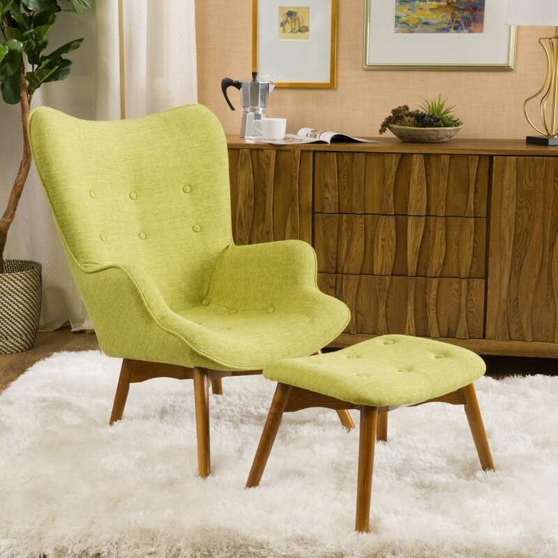 The chair and ottoman in green