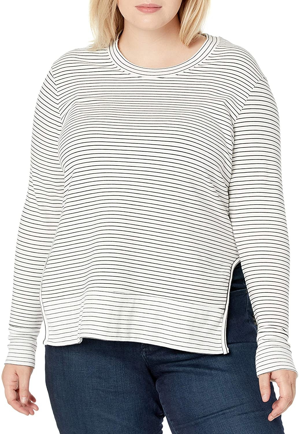 A model wearing the crewneck pullover in white with black stripes