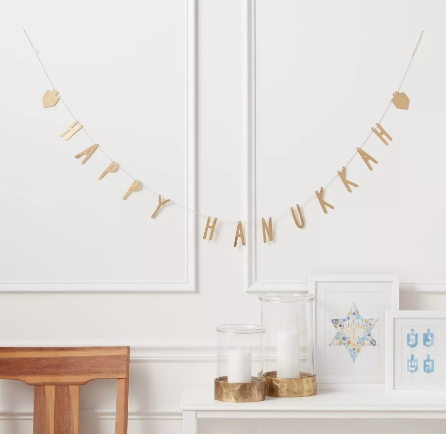 """Gold """"Happy Hannukah"""" banner with dreidels on each end"""