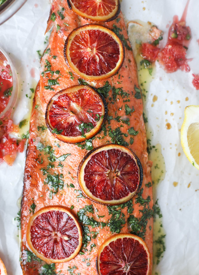 A piece of salmon topped with thinly sliced blood oranges.