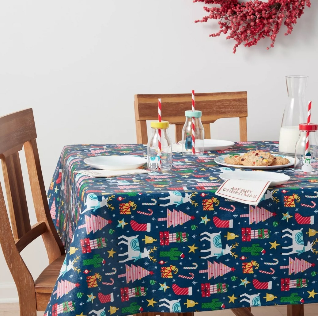 Blue vinyl tablecloth with Christmas inspired prints
