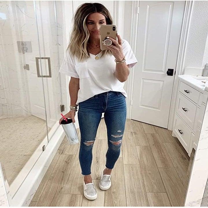 Model wearing white tee shirt