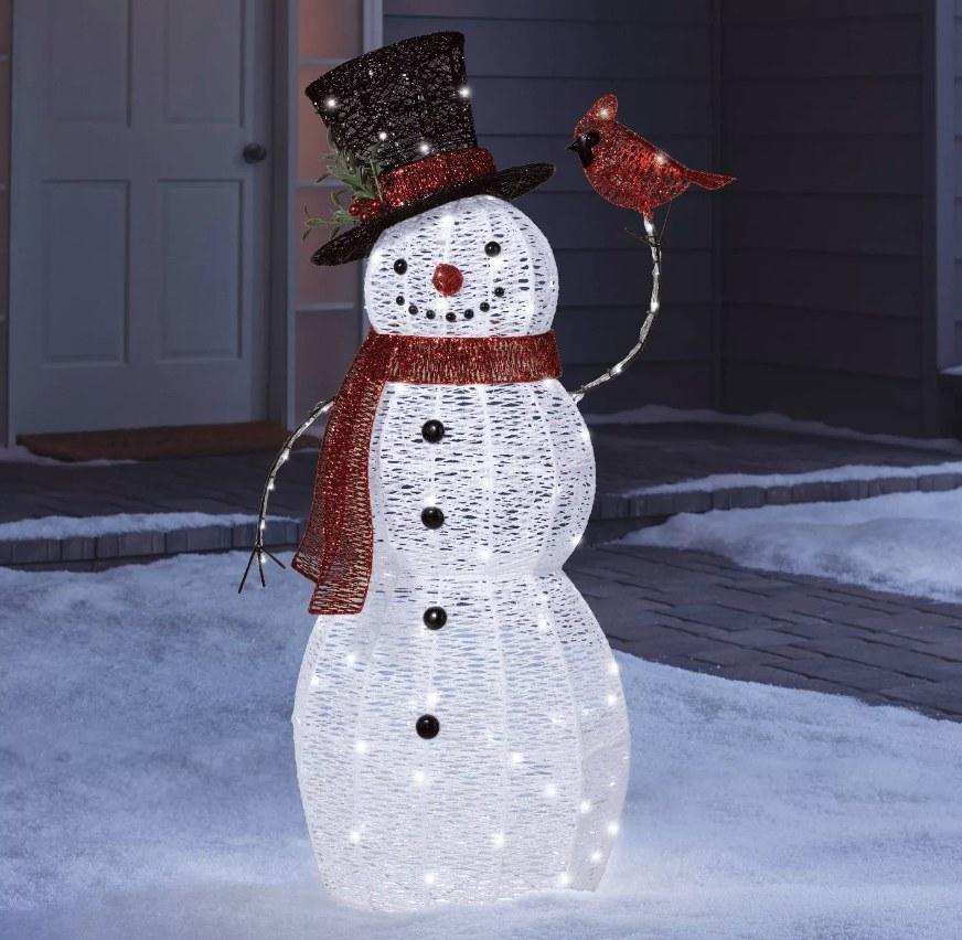 LED light up snowman holding a cardinal