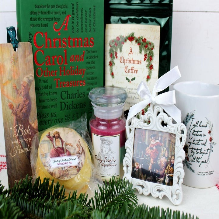 a christmas carol themed box with a book and goodies