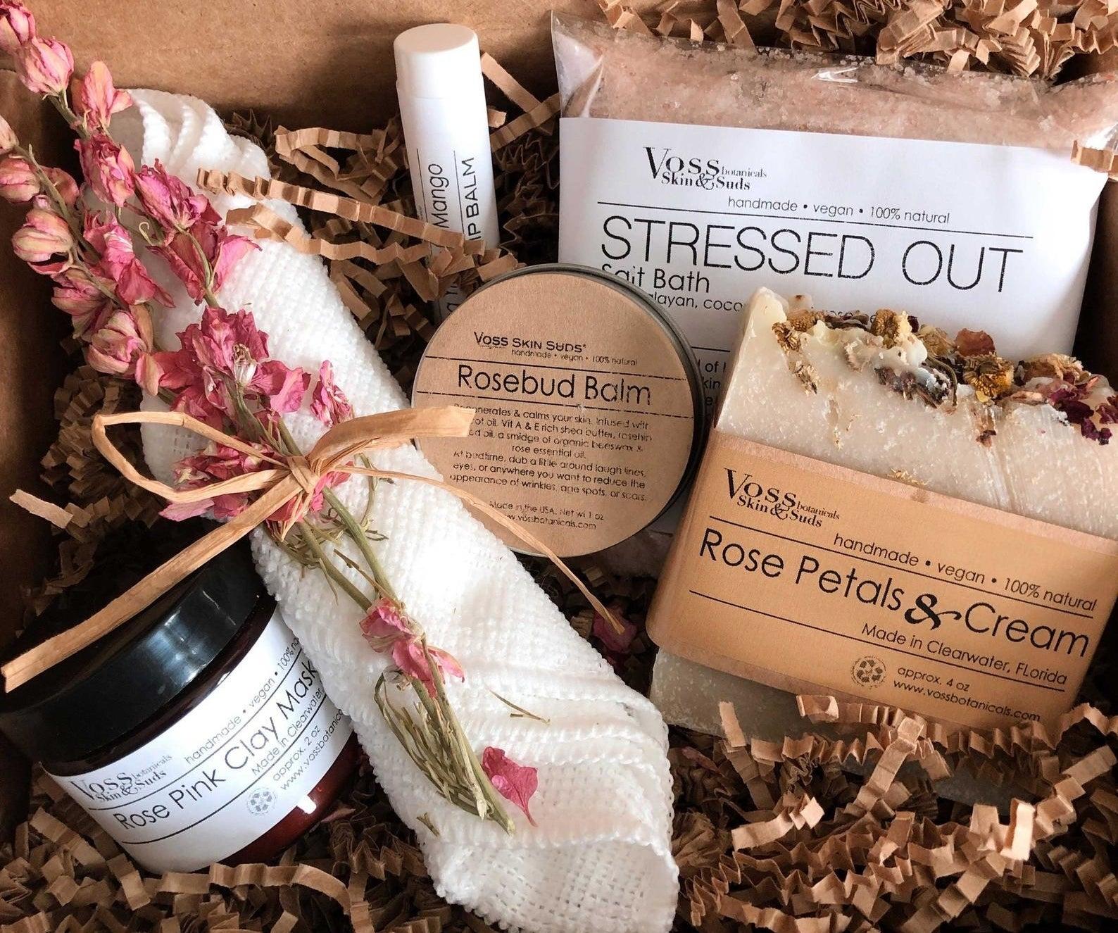 box of various spa-like products like salt bath, lip balm, and clay mask