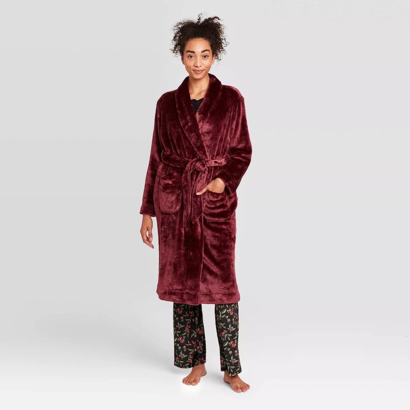 A long sleeve knee length burgundy robe.