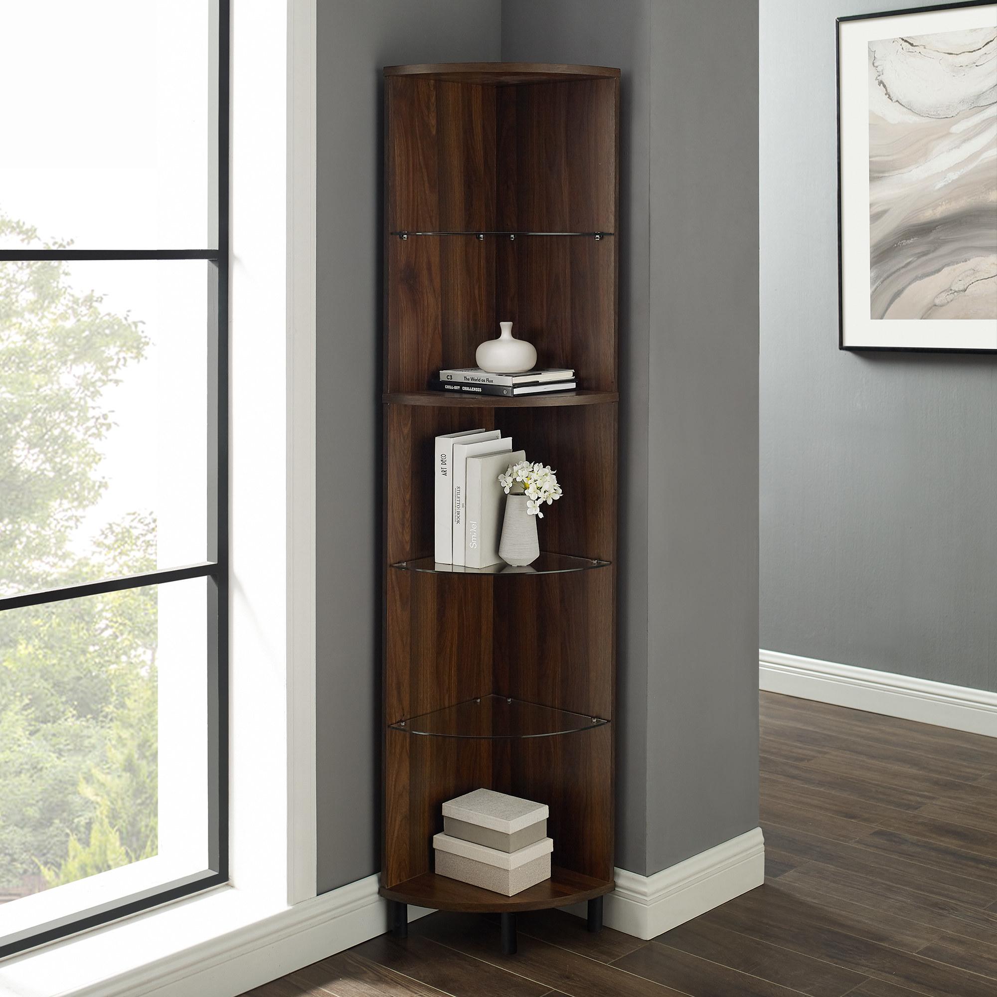 A dark brown corner bookcase