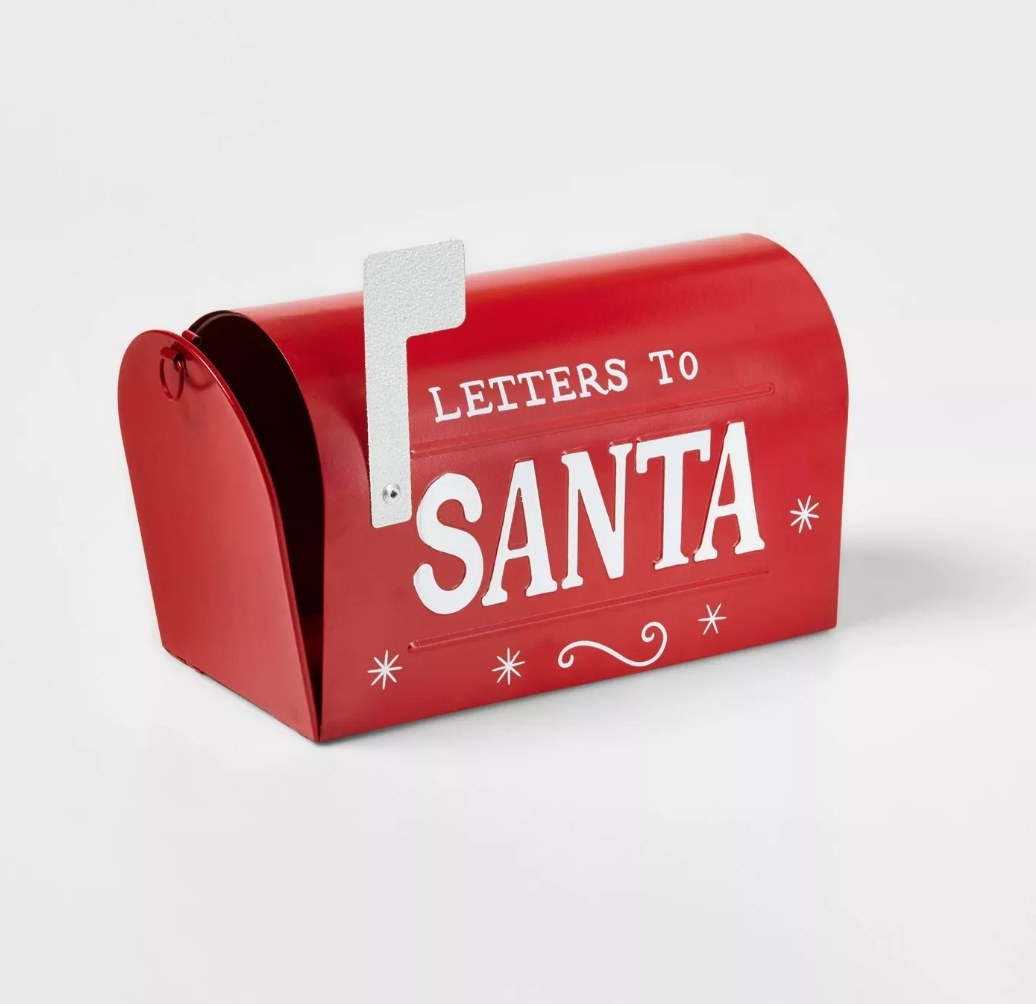 """Red traditional mailbox with white words """"Letters to Santa"""" and white mail flag"""