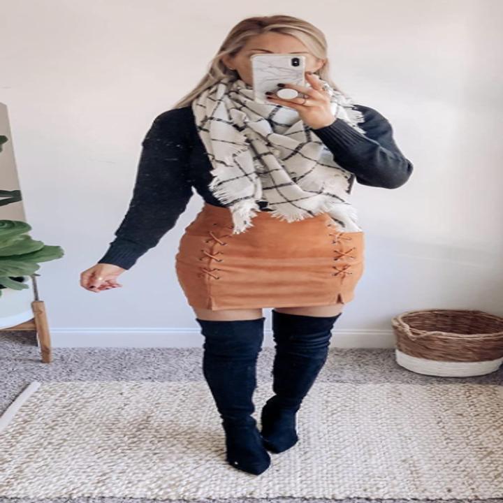 Reviewer wearing orange mini skirt