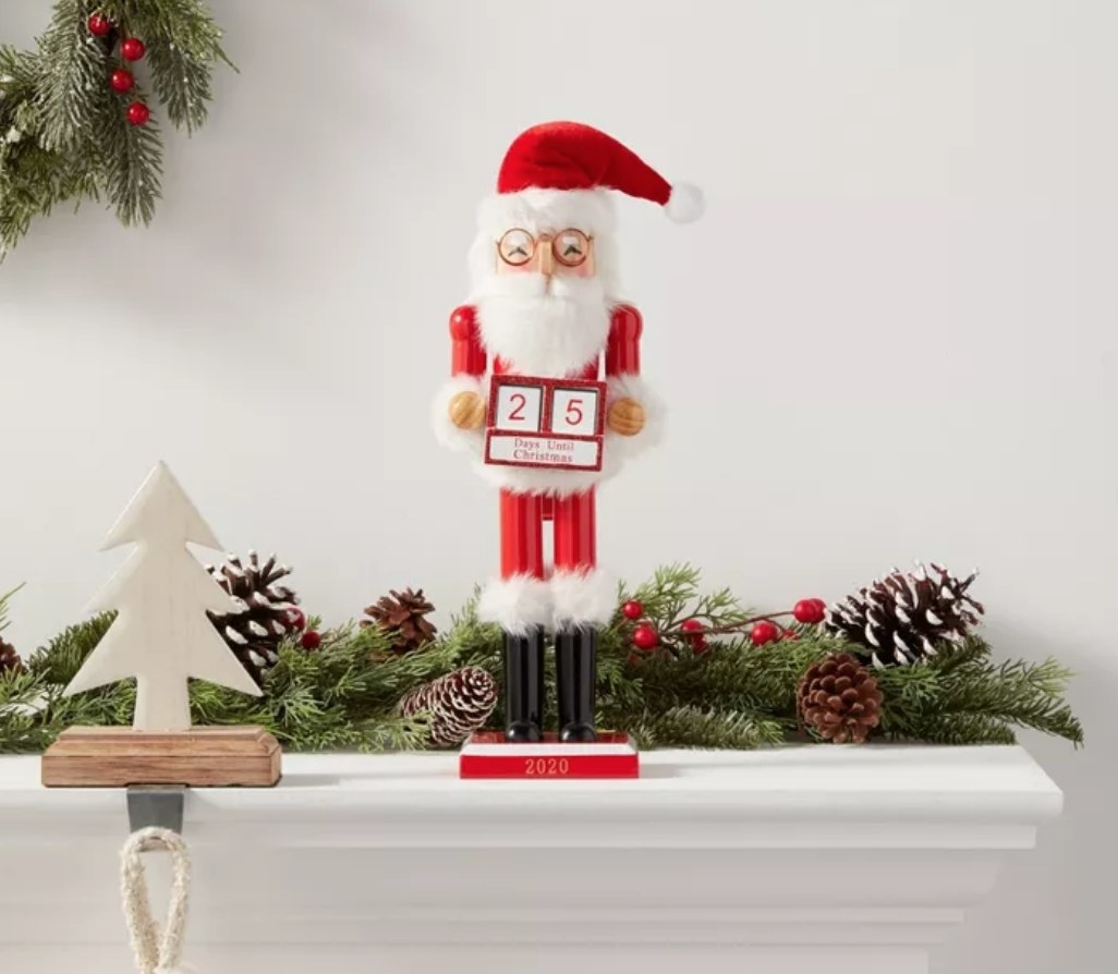 The Santa-themed nutcracker, holding a countdown calendar