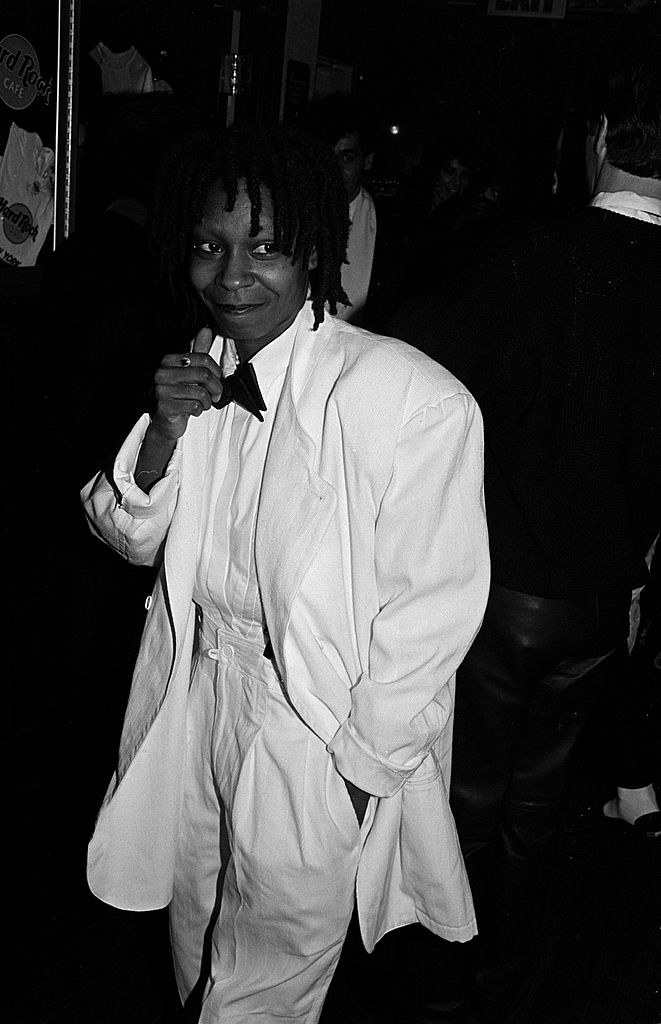 black and white picture in a white suit