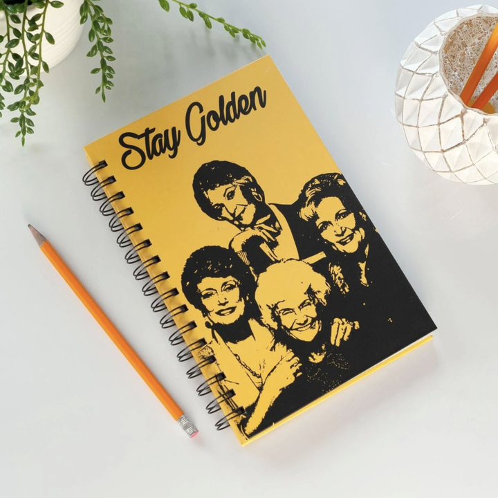 """Golden Girls notebook with photo of cast and """"Stay Golden"""" at the top"""