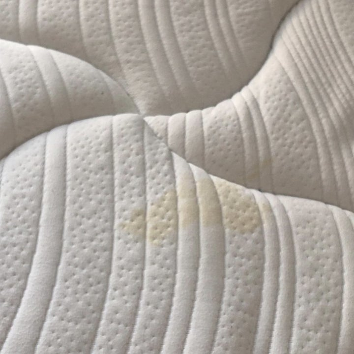 A mattress with a stain