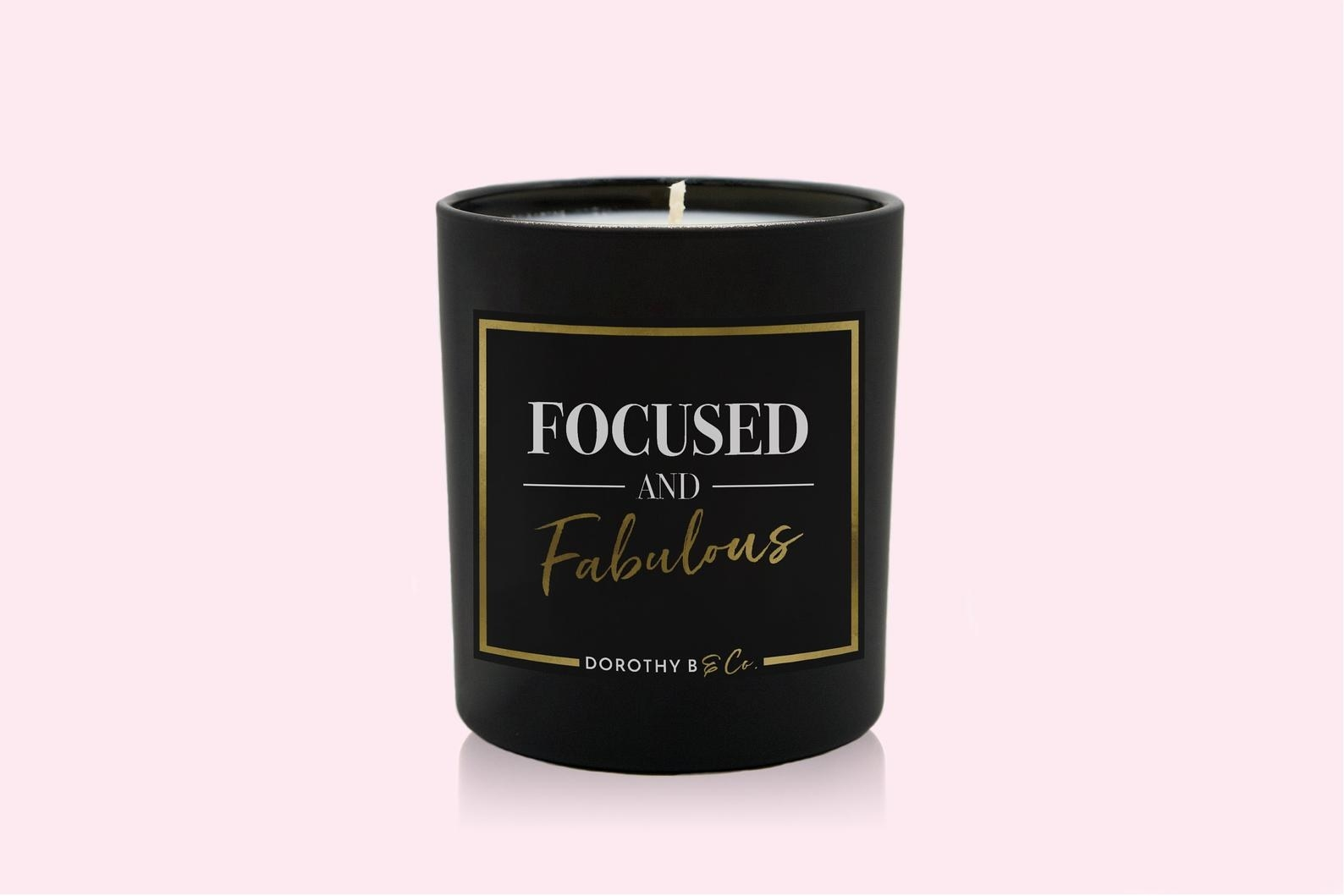 "Black jar candle that reads ""Focused and Fabulous"""
